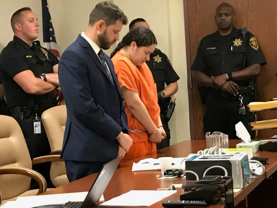 Amanda Ramirez, a Camden woman accused of killing her twin sister, appears at a court hearing with public defender Igor Levenberg earlier this year.
