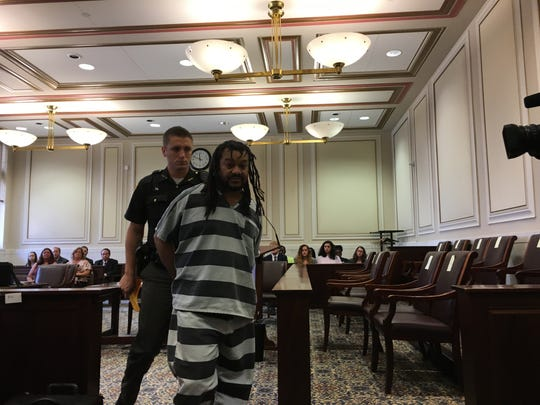 Genesis Hill is led out of Hamilton County Common Pleas Judge Lisa Allen's courtroom Thursday after being resentenced in the 1991 killing of his infant daughter. Prosecutors dismissed death penalty specifications and Hill agreed to accept a 30-year sentence.