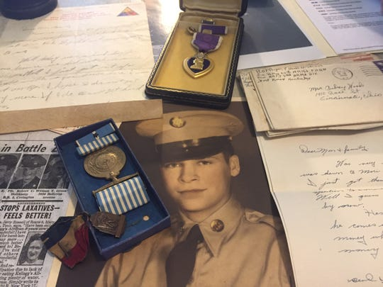 Memorabilia prized by family members of Roger Woods who has been missing in action since 1950, presumed killed in action during the Korean War.