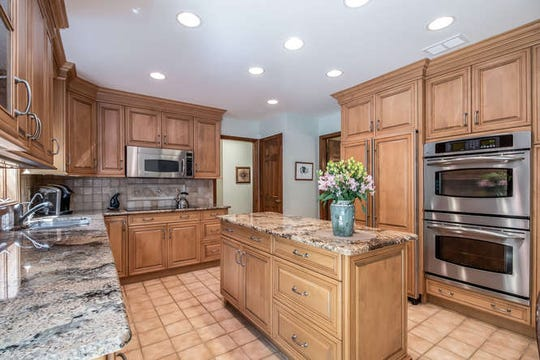 Over five level, wooded acres surround a Lebanon Township custom contemporary finished in cedar and stonework that is for sale for$499,900.