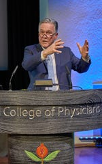 """Hackensack Meridian Health Carrier Clinic President Donald J. Parker addresses the audience at the """"Blurring the Boundaries — Designing Place-Based Health Systems"""" conference in London while explaining new trends in behavioral health campus design."""
