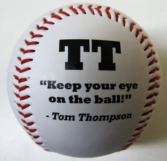 Baseball passed out to those in attendance at a recent bench dedication to Tom Thompson at the Coshocton Court Square. Thompson died of cancer last fall after a long career at WTNS Radio and as a community leader.