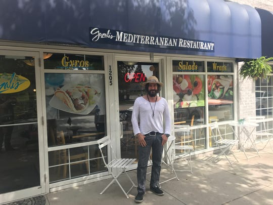 M.J. Gazali stands in front of his family's restaurant at 1205 25th St. in Des Moines.