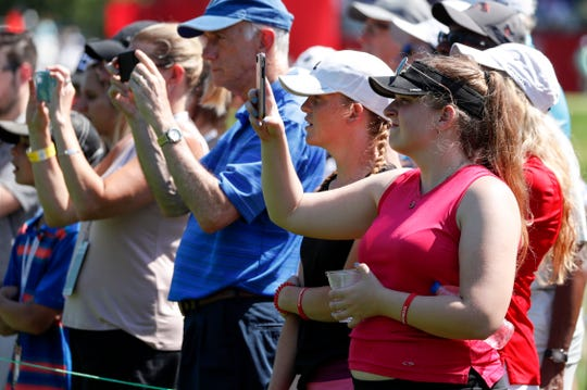 Spectators take photos as they watch during the Rocket Mortgage Classic at the Detroit Golf Club in Detroit on Thursday, June 27, 2019.