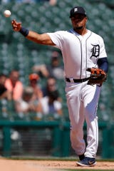 Tigers third baseman Jeimer Candelario makes a throw to first base for an out during the seventh inning of the Tigers' 3-1 loss to the Rangers on Thursday, June 27, 2019, at Comerica Park.