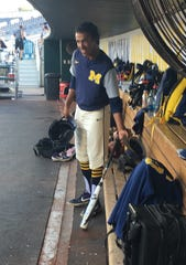 Michigan pitcher Isaiah Paige gets ready for batting practice on Wednesday in Omaha, Nebraska.