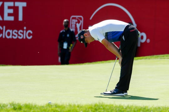 Gary Woodland reacts to a missed putt on the 14th hole.