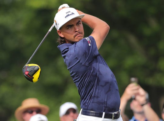Rickie Fowler hits his drive on the 9th hole during first round action of the Rocket Mortgage Classic Thursday, June 27, 2019 at the Detroit Golf Club in Detroit.