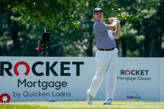 Ernie Els watches his ball on the 17th hole during the Rocket Mortgage Classic at the Detroit Golf Club in Detroit on Thursday, June 27, 2019.