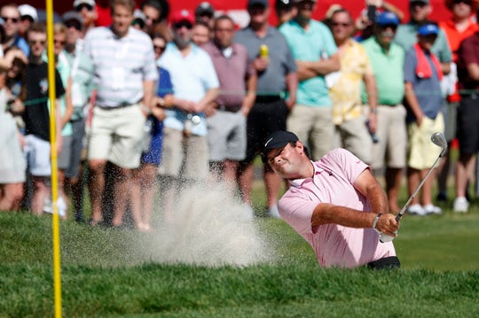 Patrick Reed plays a shot from the bunker on the 14th green during the Rocket Mortgage Classic on Thursday.