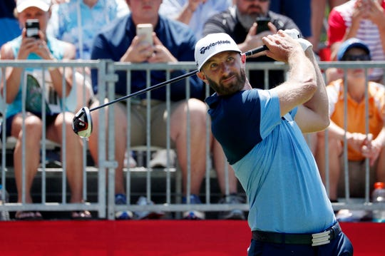 Dustin Johnson watches his ball during the Rocket Mortgage Classic at the Detroit Golf Club in Detroit on Thursday, June 27, 2019.