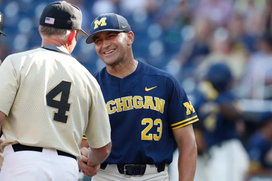 Michigan coach Erik Bakich greets Vanderbilt coach Tim Corbin prior to Game 3 of the championship series of the 2019 College World Series in Omaha, Neb., Wednesday, June 26, 2019.
