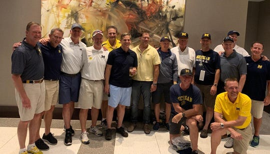 Former Michigan baseball players pose while in Omaha, Nebraska, for the College World Series.