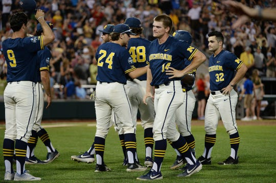 Michigan players react after losing Game 3 of the championship series of the 2019 College World Series against Vanderbilt in Omaha, Neb., Wednesday, June 26, 2019.
