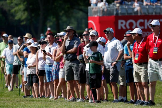 Spectators watch as golfers move through the course during the Rocket Mortgage Classic at the Detroit Golf Club in Detroit on Thursday, June 27, 2019.