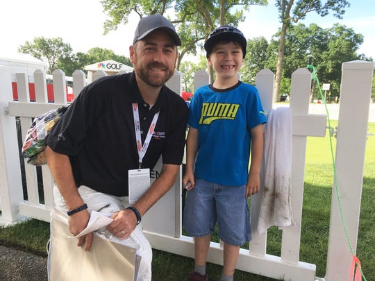 "Seven-year-old Isaac Campbell and his dad, Mike, of Warren, were enjoying their first golf tournament Thursday in Detroit. ""I want to be a golfer,"" Isaac said. ""And a baseball player and a soccer player."""