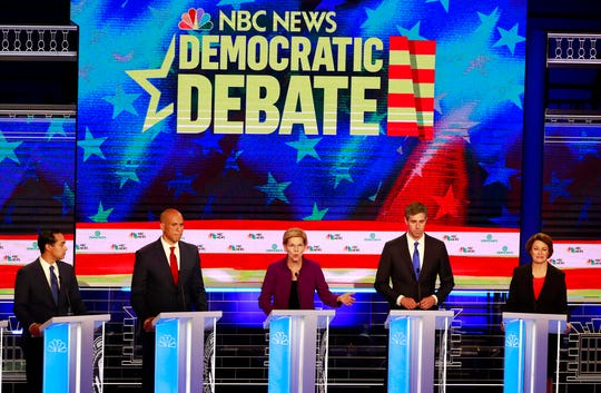 Democratic presidential candidate Sen. Elizabeth Warren, D-Mass., center, answers a question, during the Democratic primary debate. Listening from left are, former Housing and Urban Development Secretary Julian Castro, Sen. Cory Booker, D-N.J., former Texas Rep. Beto O'Rourke, and Sen. Amy Klobuchar, D-Minn.