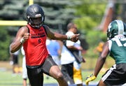 Oak Park wide receiver Maliq Carr runs a route at the Sound Mind Sound Body 7-on-7 camp on Thursday.
