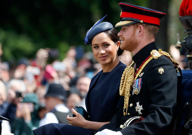 Britain's Meghan, the Duchess of Sussex and Prince Harry ride in a carriage in June to attend the annual Trooping the Colour Ceremony in London.