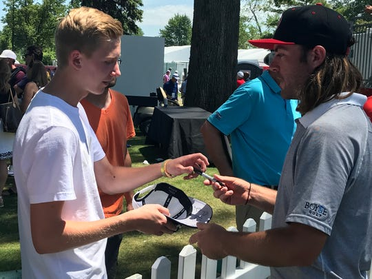 Joey Garber signs autographs after his round Thursday.