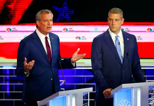 Democratic presidential candidate New York City Mayor Bill de Blasio, left, speaks as Rep. Tim Ryan, D-Ohio, listens.