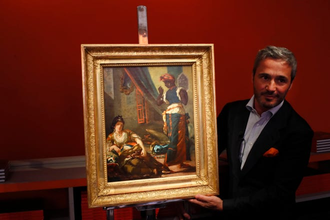 "Philippe Mendes speaks during an interview for the presentation of Eugene Delacroix, oil painting ""Women of Algiers in their Apartment"" in Paris."