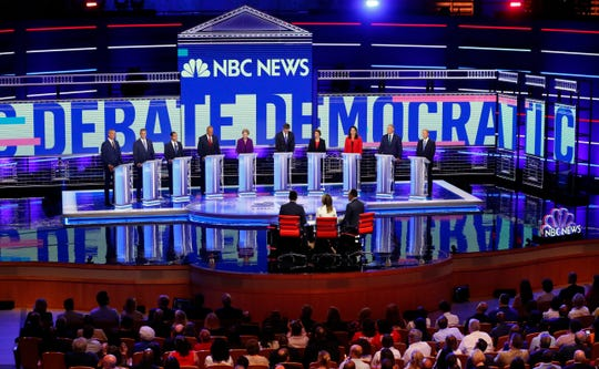 Democratic presidential candidates, from left, New York City Mayor Bill de Blasio, Rep. Tim Ryan, D-Ohio, former Housing and Urban Development Secretary Julian Castro, Sen. Cory Booker, D-N.J., Sen. Elizabeth Warren, D-Mass., former Texas Rep. Beto O'Rourke, Sen. Amy Klobuchar, D-Minn., Rep. Tulsi Gabbard, D-Hawaii, Washington Gov. Jay Inslee, and former Maryland Rep. John Delaney listen before the start of a Democratic primary debate.
