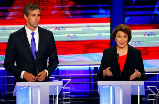 Democratic presidential candidate Sen. Amy Klobuchar, D-Minn., speaks as former Texas Rep. Beto O'Rourke listens.
