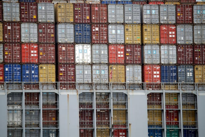 Cargo containers are stacked on a ship at the Port of Los Angeles in Los Angeles.