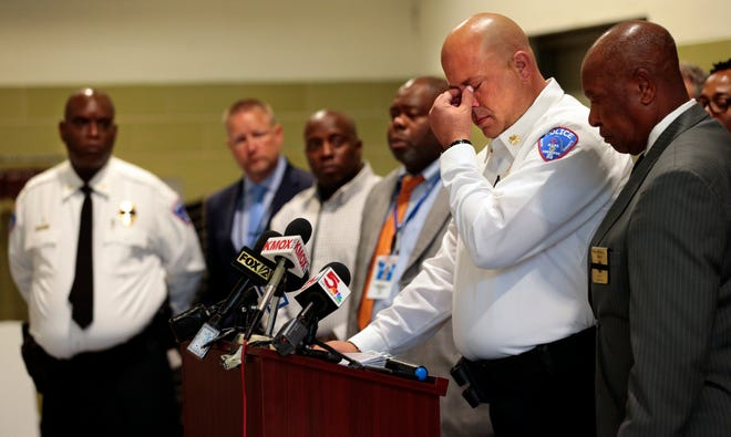 North County Police Cooperative Major Ron Martin addresses the media with support from Vinita Park Mayor James McGee as he talks about fallen police officer Michael Langsdorf during a news conference at Beyond Housing on Monday, June 24, 2019.