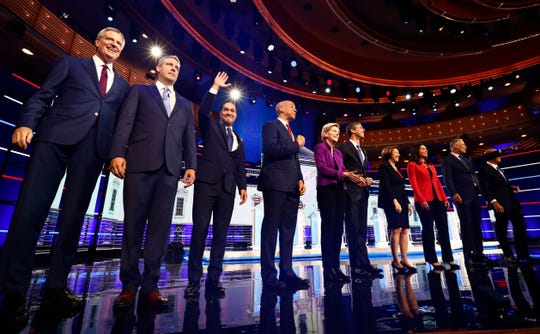 From left, New York City Mayor Bill de Blasio, Rep. Tim Ryan, D-Ohio, former Housing and Urban Development Secretary Julian Castro, Sen. Cory Booker, D-N.J., Sen. Elizabeth Warren, D-Mass., former Texas Rep. Beto O'Rourke, Sen. Amy Klobuchar, D-Minn., Rep. Tulsi Gabbard, D-Hawaii, Washington Gov. Jay Inslee, and former Maryland Rep. John Delaney pose for a photo on stage before the start of a Democratic primary debate.