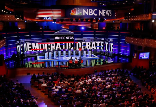 Democratic presidential candidates listen to a question during the Democratic primary debate hosted by NBC News at the Adrienne Arsht Center for the Performing Art, Wednesday, June 26, 2019, in Miami.