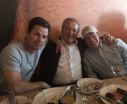 Actor Mark Wahlberg, Nino Cutraro, and Paul Wahlberg