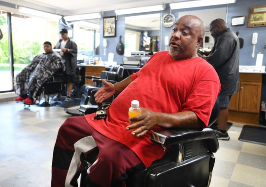 "Michael Brown, 52, at Master's Beauty and Barber Shop, said, ""You might as well take 'trust' out of the dictionary when it comes to how the people feel about our people in office in Flint."""