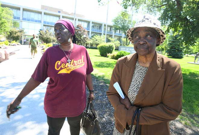 """They need to make these people be held accountable for their actions (in the Flint water crisis),"" said Flint resident Jetty Walker, 61, left, seen with her mother Georgia Walker, 85, in front of the Flint Municipal Center."
