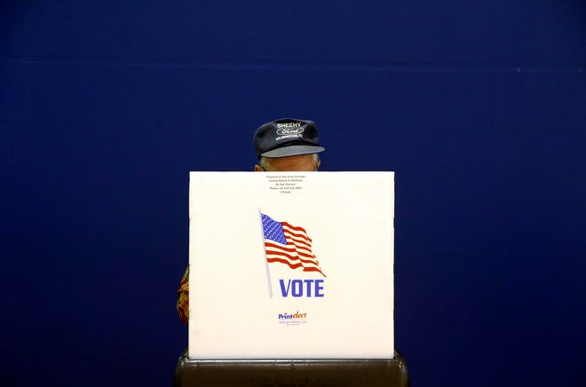A voter fills out a ballot in November at a polling place at Lake Shore Elementary School, in Pasadena, Md.
