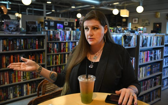 "Activist Melissa May at the Totem Bookstore in Flint, said, ""They want to hold us accountable for these water bills. The politicians skate and then we're the scapegoats."""