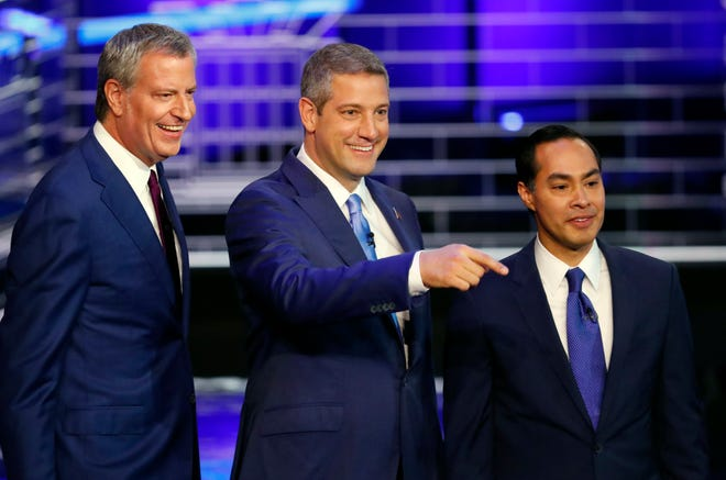 Democratic presidential candidates New York City Mayor Bill de Blasio, Rep. Tim Ryan, D-Ohio, and former Housing and Urban Development Secretary Julian Castro stand on the stage before a Democratic primary debate.
