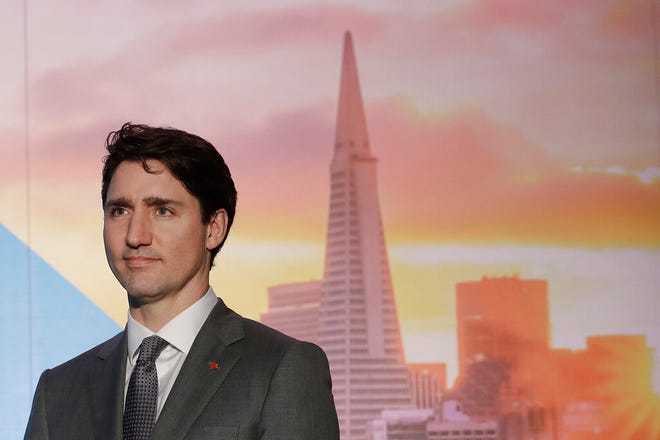 Canada's Prime Minister Justin Trudeau waits to speak at the AppDirect office in San Francisco.