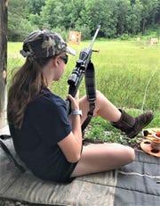 Kaitlin Wheeler, a member of Sullivan's Sharpshooters, prepares to fire her .22-caliber rifle toward a downrange target at the Chemung County Rod & Gun Club in Breesport. The club will host a major NRA youth championship in July.