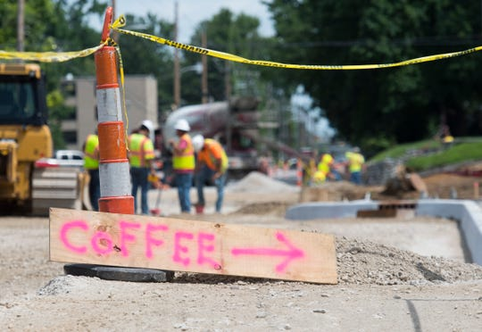 A sign painted by a Ragle Inc. employee rests on the ground directing customers to Honey Moon Coffee Co. through a work site at the intersection of Weinbach and Lincoln Ave. Thursday, June 27, 2019.