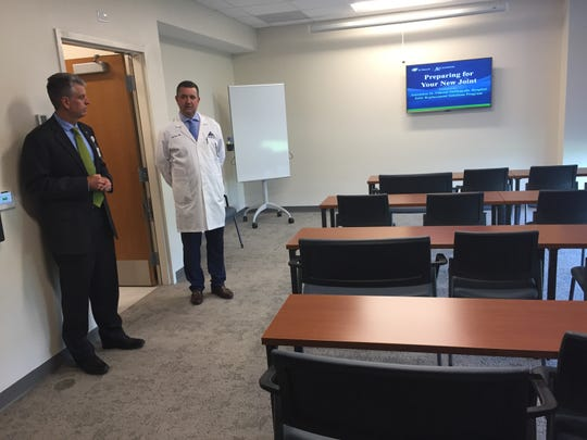 "John Greaney, vice president of operations with St. Vincent Evansville, and Dr. Paul Perry of Tri-State Orthopaedic Surgeons show the ""education room"" in the newly constructed Ascension St. Vincent Orthopedic Hospital in Warrick County."