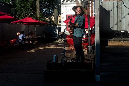 Ben Dahlquist, top center, plays music for the dinner crowd on the patio of Sauced located in the Haynie's Corner Arts District neighborhood, Tuesday, June 25, 2019. The local singer-songwriter performs on the patio most Tuesday evenings, weather permitting, during the summer.