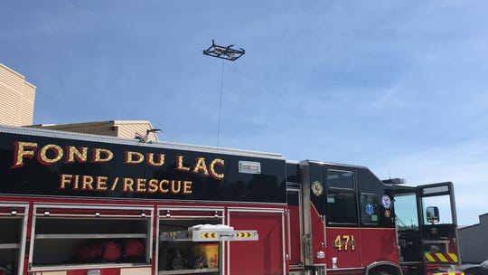 A tethered drone created by Pierce Manufacturing ascends above a Fond du Lac Fire/Rescue truck during a demonstration on June 27, 2019.