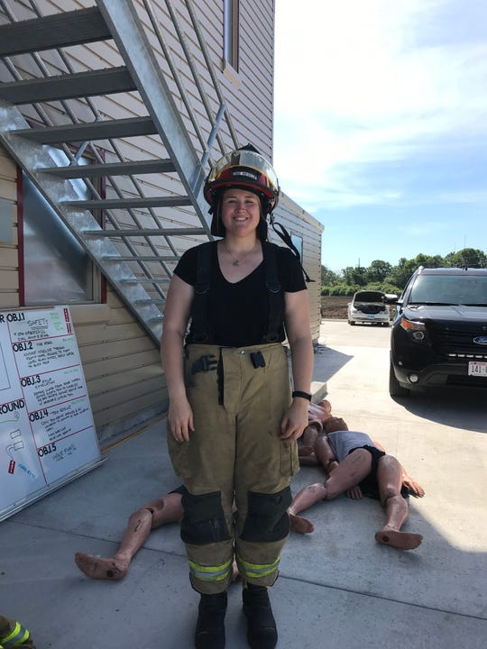 Reporter Sarah Razner stands in front of  dummies used in simulations Thursday, June 27, 2019 at Fond du Lac Fire/Rescue's Media Day.