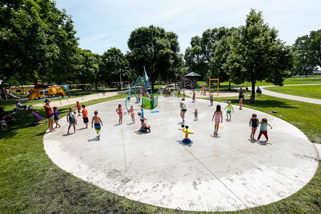 Children play on the new splash pad Thursday, June 27, 2019 in Lakeside Park in Fond du Lac, Wis.