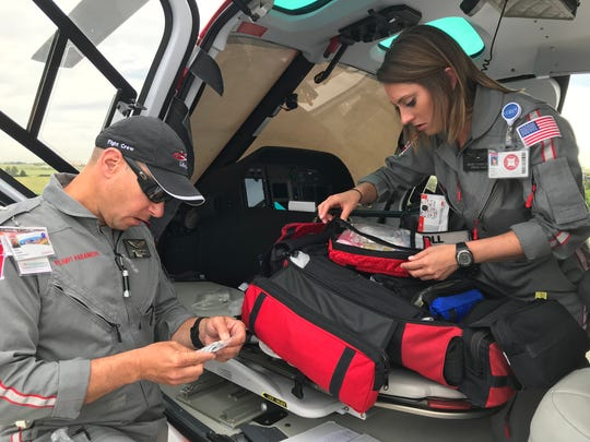 UCHealth LifeLine pilot Kris Schott, left, and nurse Hilary Fischer check the helicopter's medical supplies while starting their 12-hour shift Tuesday at Medical Center of the Rockies in Loveland.