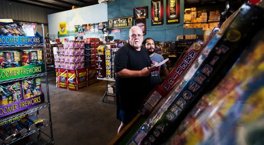 Chris Whited the owner of American Discount Fireworks and his manager, JP Porog look through the inventory of the store on Thursday June, 27, 2019. They are preparing for the onslaught of the Fourth of July holiday.