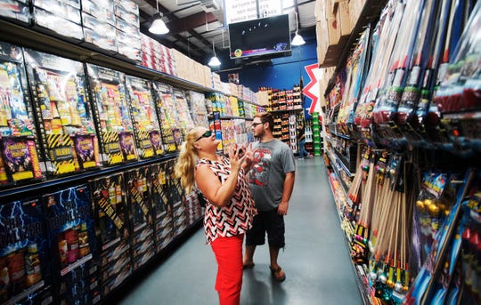 Carey DePree and her son, Gavin  shop at SkyKing Fireworks in Fort Myers on Thursday June, 27, 2019. The store is preparing for the onslaught of the Fourth of July holiday.