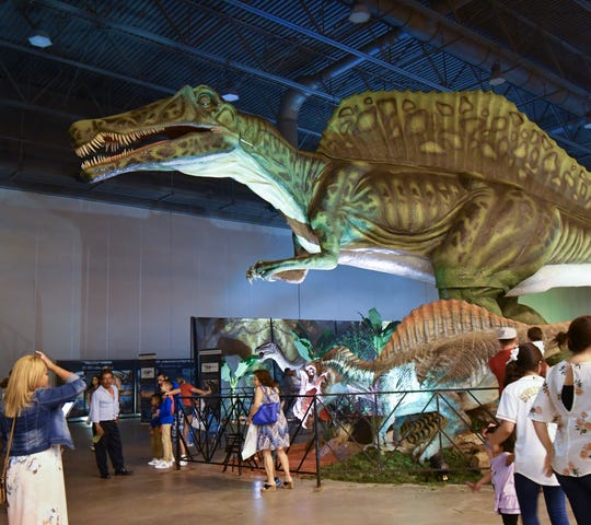 The Jurassic Quest tour features more than 80 moving, roaring, realistic-looking dinosaurs.
